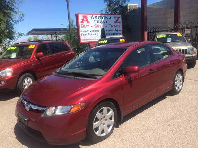2007 HONDA CIVIC LX 4DR SEDAN red this vehicle in excellent condition supper clean inside outside