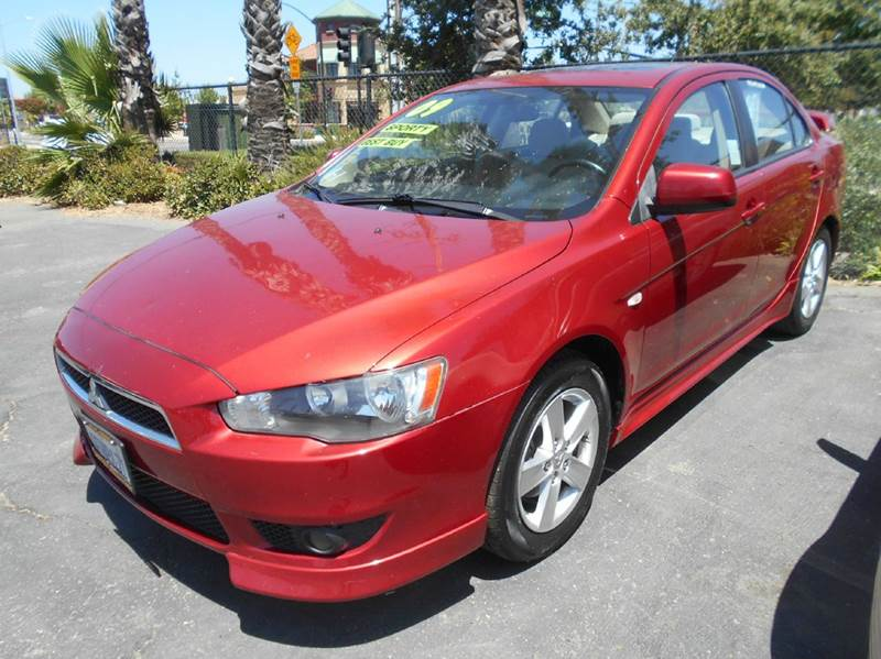 2009 MITSUBISHI LANCER ES 4DR SEDAN 5M red 2-stage unlocking doors abs - 4-wheel active head re
