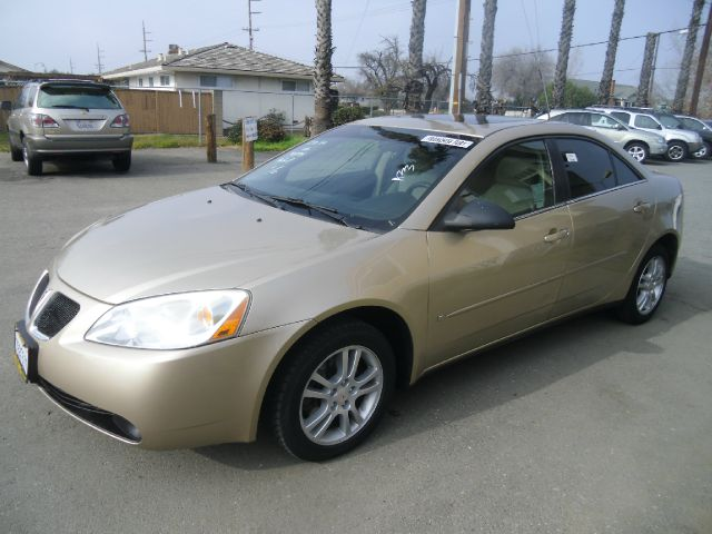 2006 PONTIAC G6 BASE 4DR SEDAN gold antenna type anti-theft system - engine immobilizer center c