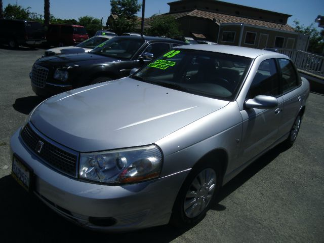 2003 SATURN L-SERIES L200 4DR SEDAN silver abs - 4-wheel anti-theft system - alarm center conso