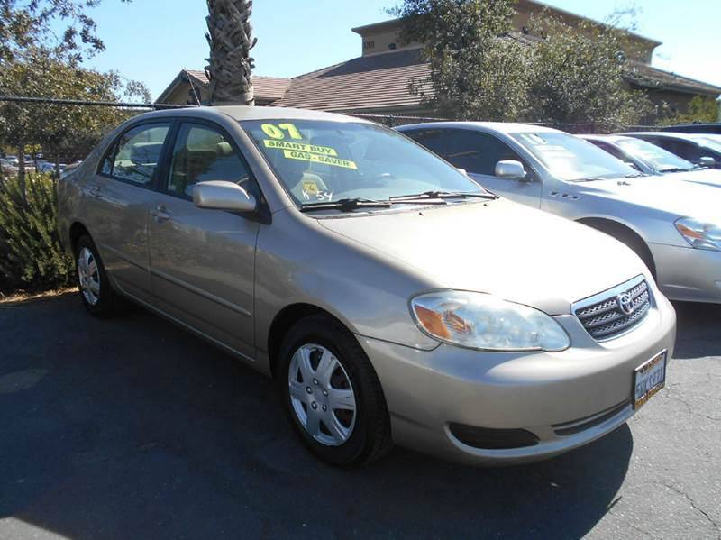 2007 TOYOTA COROLLA LE 4DR SEDAN 18L I4 4A gold 2-stage unlocking doors air filtration anten