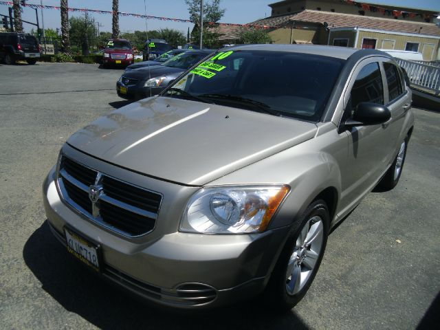 2010 DODGE CALIBER SXT 4DR WAGON gold 2-stage unlocking abs - 4-wheel adjustable rear headrests