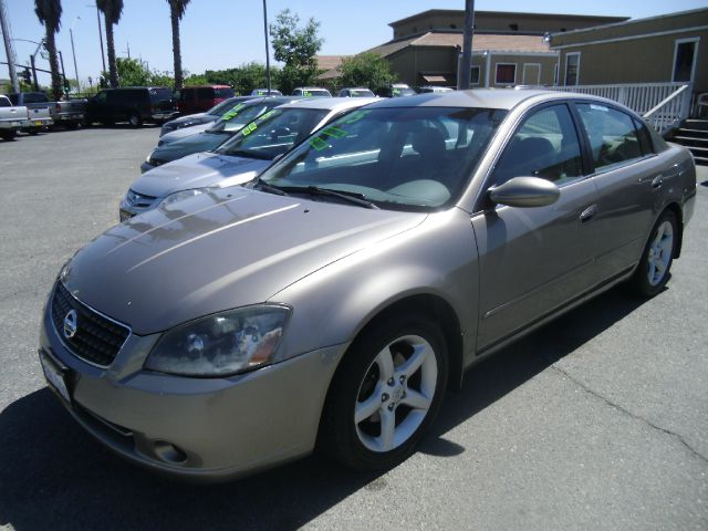 2005 NISSAN ALTIMA 35 SE 4DR SEDAN gold anti-theft system - alarm center console - front consol