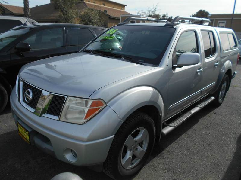 2006 NISSAN FRONTIER SE 4DR CREW CAB SB WAUTOMATIC silver abs - 4-wheel active head restraints