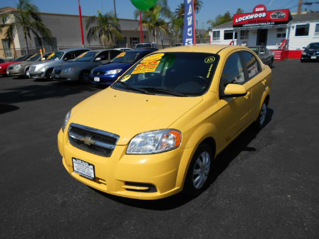 2010 CHEVROLET AVEO LT 4DR SEDAN W1LT yellow just got inanother quality vehicle offer by lock