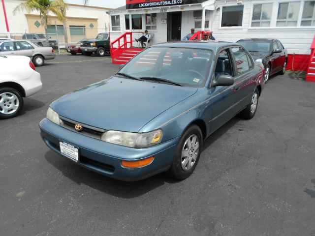1994 TOYOTA COROLLA DX 4DR SEDAN blue this gas saving road warrior is a  1994 toyota corolla is  v