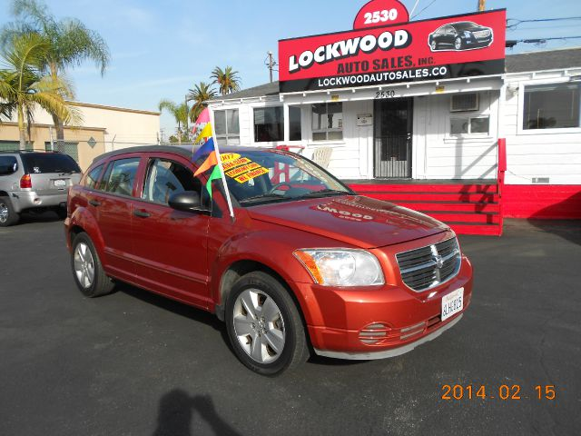 2007 DODGE CALIBER SXT orange just arrivedthis 2007 dodge caliber  is an edgy boxy crossover