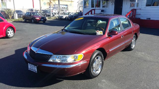 2002 LINCOLN CONTINENTAL BASE 4DR SEDAN burgundy this handsome 2002 lincoln continental is in fant