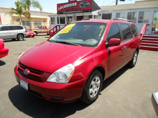 2009 KIA SEDONA LX 4DR MINI VAN red this gorgeous 2009 kia sedona is in fantastic condition low
