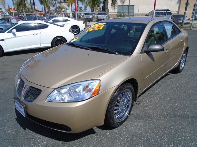 2007 PONTIAC G6 BASE 4DR SEDAN gold this 2007 pontiac g6 is a great reliable commuter car to own