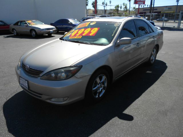 2002 TOYOTA CAMRY SE V6 4DR SEDAN gold this 2002 toyota camry is a very clean and reliable machine