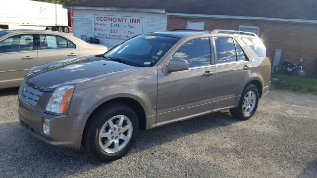 2007 CADILLAC SRX V6 4DR SUV champagne 2-stage unlocking doors abs - 4-wheel airbag deactivatio