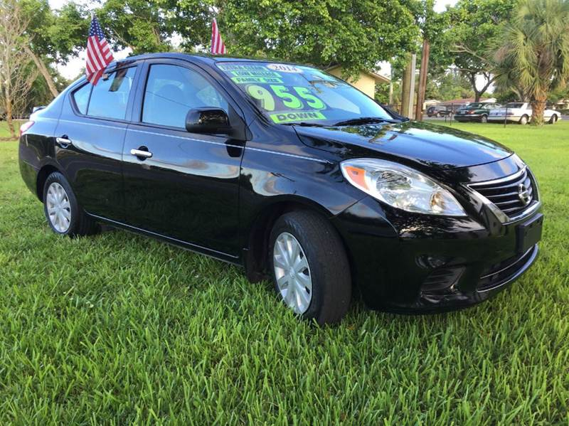 2014 NISSAN VERSA 16 SV 4DR SEDAN black this vehicle is extermely clean you can not find anotgher