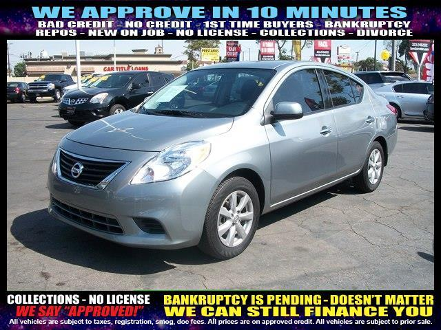 2014 NISSAN VERSA charcoal  welcome take a test drive or call us if you have any questions y