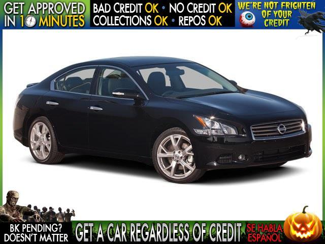 2005 NISSAN MAXIMA maroon  welcome take a test drive or call us if you have any questions yo