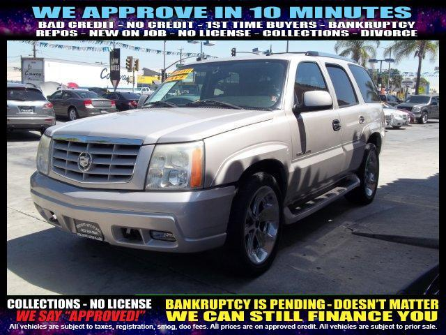 2004 CADILLAC ESCALADE BASE AWD 4DR SUV gold  welcome take a test drive or call us if you have