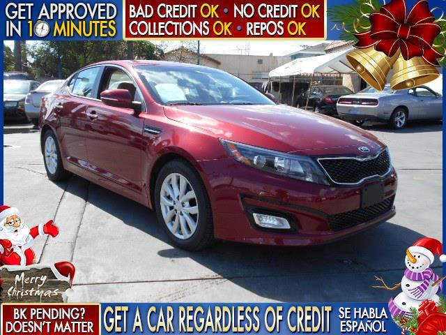 2015 KIA OPTIMA LX 4DR SEDAN red  welcome take a test drive or call us if you have any questio