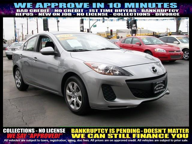 2012 MAZDA MAZDA3 silver welcome take a test drive or call us if you have any questions you