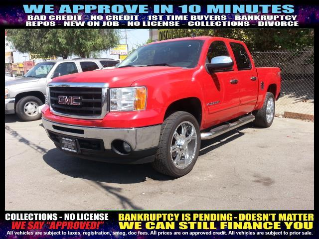 2009 GMC SIERRA 1500 SLE 4X2 PICKUP CREW CAB 4DR red welcome take a test drive or call us if yo