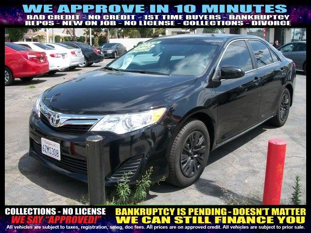2013 TOYOTA CAMRY black welcome take a test drive or call us if you have any questions you