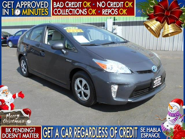 2012 TOYOTA PRIUS silver  welcome take a test drive or call us if you have any questions you