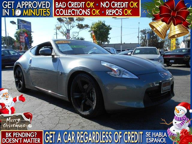 2012 NISSAN 370Z gray  welcome take a test drive or call us if you have any questions you wo