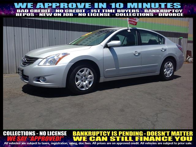 2011 NISSAN ALTIMA silver  welcome take a test drive or call us if you have any questions yo