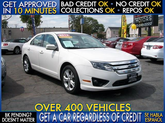 2012 FORD FUSION SE 4DR SEDAN white  welcome take a test drive or call us if you have any ques