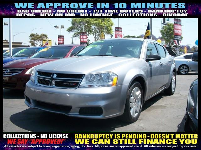 2014 DODGE AVENGER SE 4DR SEDAN silver  welcome take a test drive or call us if you have any q