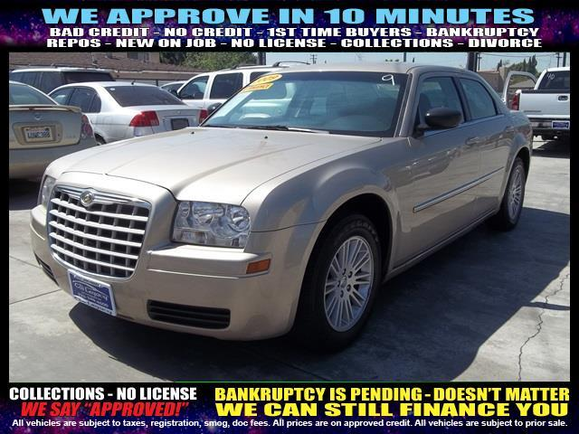 2009 CHRYSLER 300 LX 4DR SEDAN tan welcome take a test drive or call us if you have any questio