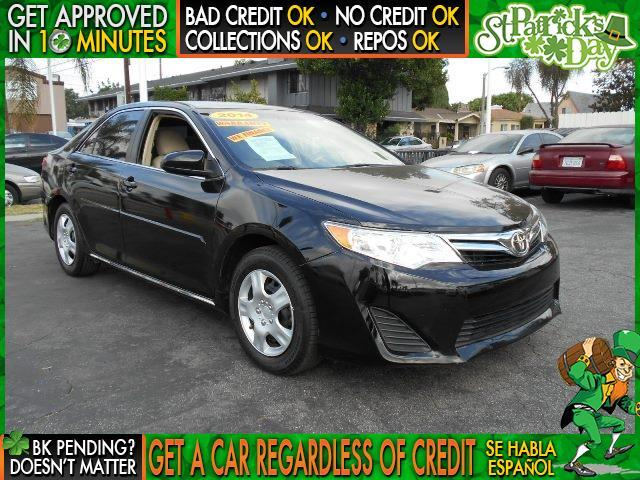 2014 TOYOTA CAMRY LE black welcome take a test drive or call us if you have any questions y