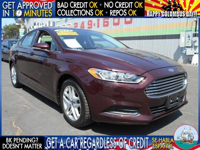 2013 FORD FUSION SE 4DR SEDAN maroon  welcome take a test drive or call us if you have any que