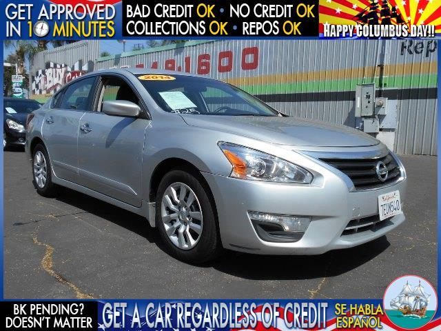 2014 NISSAN ALTIMA silver  welcome take a test drive or call us if you have any questions yo