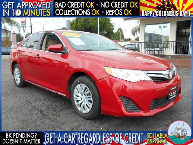 2012 TOYOTA CAMRY red  welcome take a test drive or call us if you have any questions you wo