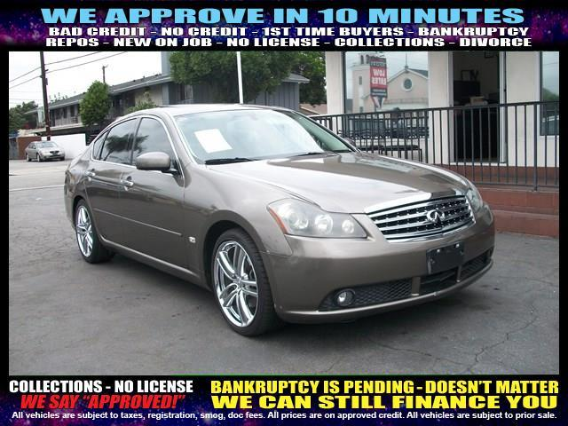 2006 INFINITI M45 gold welcome take a test drive or call us if you have any questions you won