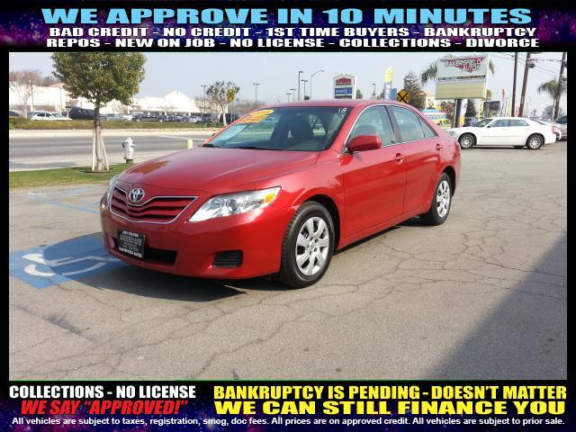 2011 TOYOTA CAMRY red  welcome take a test drive or call us if you have any questions you wo