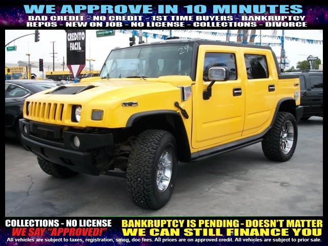 2005 HUMMER H2 SUT BASE 4DR CREW CAB 4WD SB yellow welcome take a test drive or call us if yo