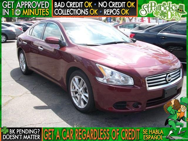 2013 NISSAN MAXIMA maroon  welcome take a test drive or call us if you have any questions yo