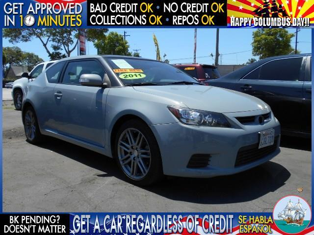 2011 SCION TC BASE 2DR COUPE 6A gray  welcome take a test drive or call us if you have any que