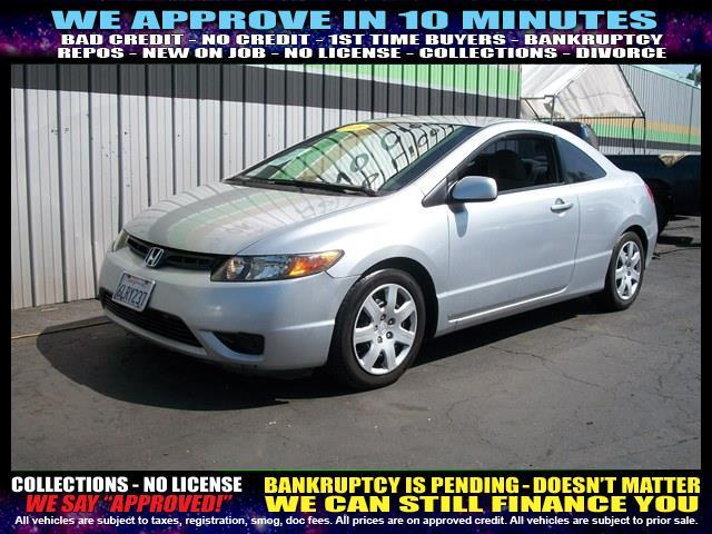 2007 HONDA CIVIC LX 2DR COUPE silver  welcome take a test drive or call us if you have any que