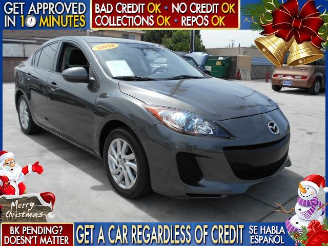 2012 MAZDA MAZDA3 I GRAND TOURING 4DR SEDAN gray  welcome take a test drive or call us if you