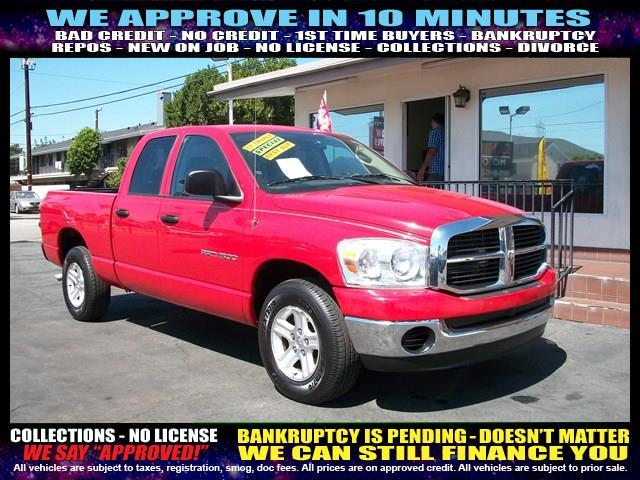 2007 DODGE RAM PICKUP 1500 red welcome take a test drive or call us if you have any questions