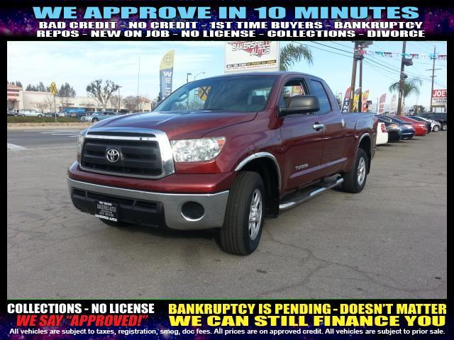 2010 TOYOTA TUNDRA GRADE 4X2 4DR DOUBLE CAB PICKUP red  welcome take a test drive or call us i
