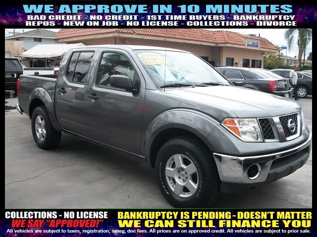 2006 NISSAN FRONTIER charcoal  welcome take a test drive or call us if you have any questions