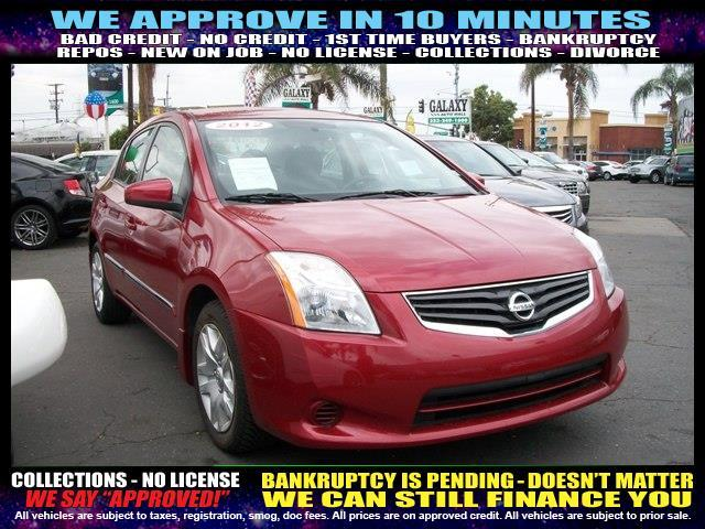 2012 NISSAN SENTRA red welcome take a test drive or call us if you have any questions you w