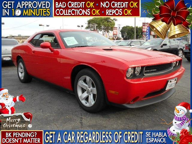 2014 DODGE CHALLENGER red  welcome take a test drive or call us if you have any questions yo