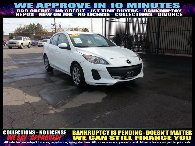 2012 MAZDA MAZDA3 white welcome take a test drive or call us if you have any questions you wo