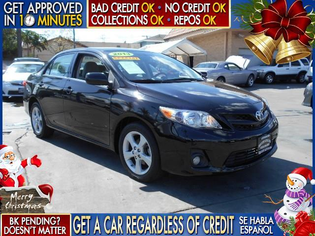 2013 TOYOTA COROLLA black  welcome take a test drive or call us if you have any questions yo