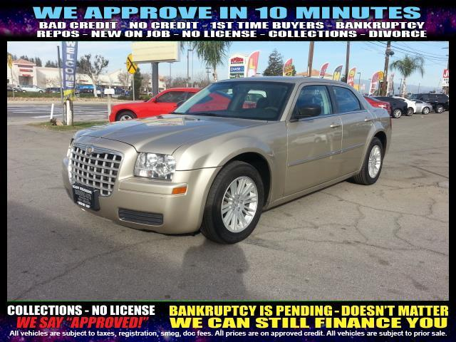 2009 CHRYSLER 300 LX 4DR SEDAN gold  welcome take a test drive or call us if you have any ques