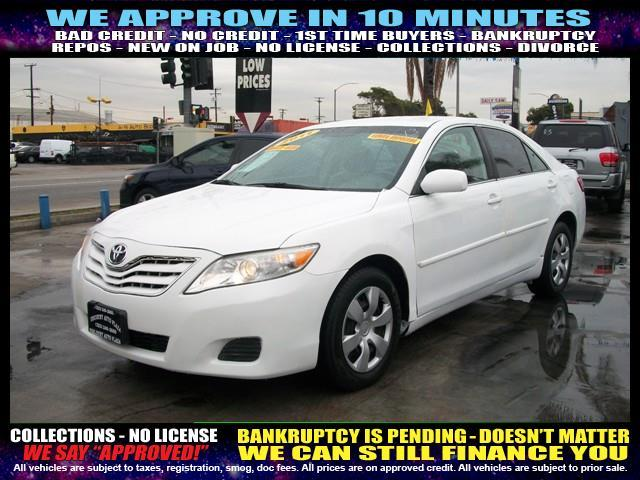 2011 TOYOTA CAMRY white  welcome take a test drive or call us if you have any questions you